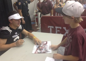 Johnny Manziel poisoning my son by being personable and friendly as he signs roughly his 490th autograph in 90 minutes.